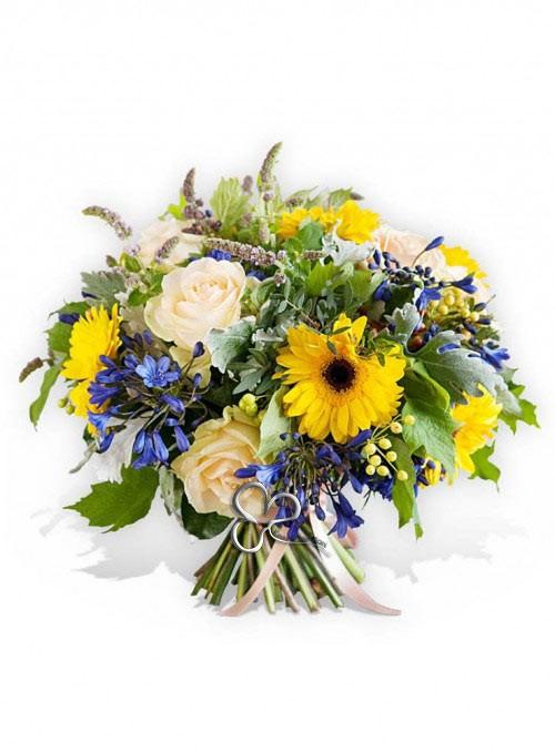 Bouquet con girasoli, gerbere, rose bianche, agapantus e verde decorativo.